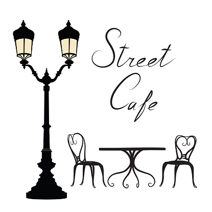 Street cafe - table, chairs, streetlight and lettering City life