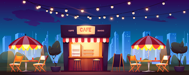 Street cafe with coffee and snacks at night