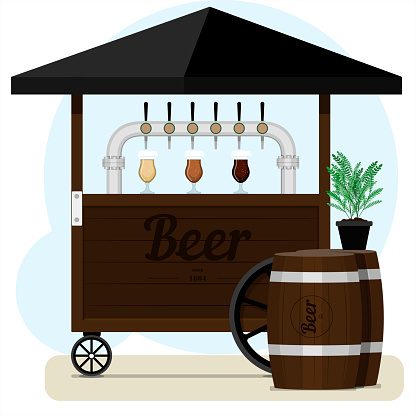 Street stall with draught beer for sale. Wooden cart with different types of craft beer, wooden barrels and beer glass glasses. Street point for selling light alcohol in parks, on the street, on the beach, at a fair or square. Colorful bar with an umbrell