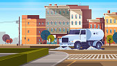 street sweeper truck on crossroad washing asphalt with water industrial vehicle cleaning machine urban road service concept modern city buildings cityscape background flat horizontal vector illustration