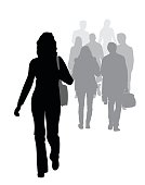 Woman's figure in silhouette, walking down the street with other silhouettes in gray.