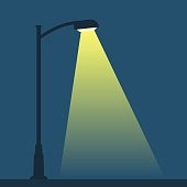 Streetlight lamp post on dark background with spotlight. Simple vector illustration of night street.