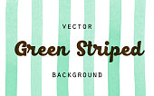 Striped green paint brush watercolor vector background. Vertical stripes isolated on white background. Green abstract hand drawn textured lines for farm, food, eco design