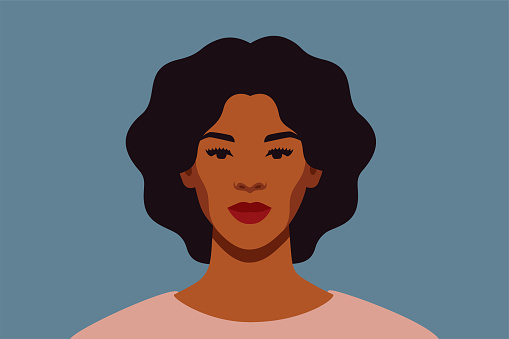 Strong Black woman with curly hair smiles and looks directly. Confident young woman with brown skin portrait front view on a blue background.