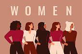 istock Strong five women and girls of different nationalities and cultures stand together. Union of feminists or sisterhood. Concept of gender equality and female empowerment movement. 1282348211