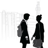 A vector silhouette illustration of a young couple standing by each other wearing, headphones, backpack, and a shoulder bag in front of the outline of a building.