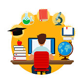 Student sitting at desk in online learning process. School homework. Concepts of education and e-learning.