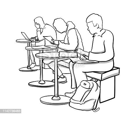 Students working at small tables in a college cafeteria