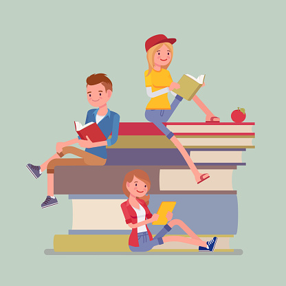 Students on a book pile