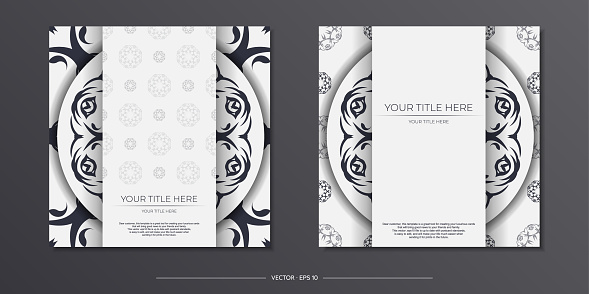 Stylish white postcard design with vintage patterns. Stylish invitation with dewy ornament.