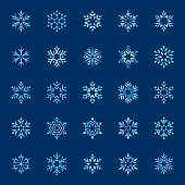 Set of stylized snowflakes. Vector design elements, icon set. Collection of different variations. Blue snowflakes on dark background.
