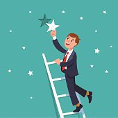 Successful businessman standing on ladder of success and reaching goals holding a star