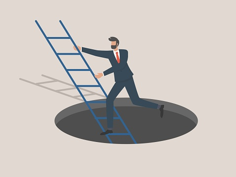 Successful businessmen escape out of the dark cave using a ladder, successful businessmen out of adversity.