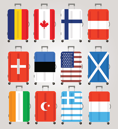 Suitcase icons set. 12 Suitcases with flags of different countries.
