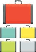 Five different color suitcases