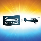 Message banner and biplane with sunset glow background. EPS 10 file. Transparency effects used on highlight elements.