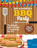 Summer picnic and BBQ invitation flyer or template. Text is on its own layer for easy editing. There is a plate piled with hamburgers on a red paid tablecloth. There are paper plates and plastic cups. Wood background.