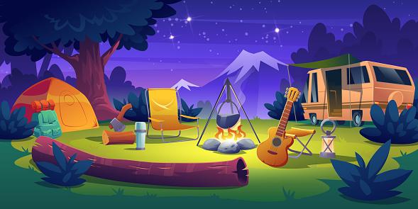 Summer camp at night time. Rv caravan at campfire