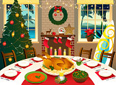 Dining room interior prepared for a Christmas dinner in a tropical climate.