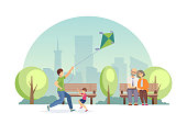 Summer city park of rest and entertainments. Elderly couple sits on bench in an embrace and rests, dad with kids play with flying kite. Joint rest, days off vector