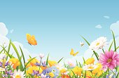 Illustration of meadow full of beautiful flowers, bees and butterflies in spring or summer. In the background is a landscape with hills and a bright blue sky with clouds. Vector illustration with space for text. EPS 10, grouped and labeled in layers.