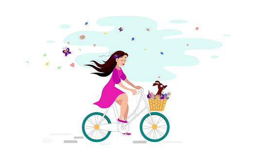 Summer girl on a bike with a dog