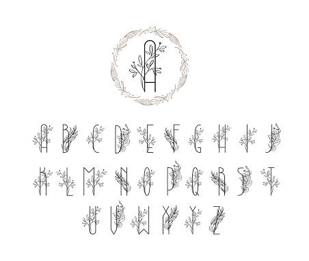 Summer or spring floral font logo. Floral vintage uppercase alphabet logo. Wedding invitation template, Elegant letters with branch of tree