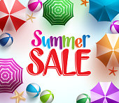 Summer Sale in Colorful Umbrella Background with Beach Balls
