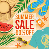 Summer Sale text n the sand with beach summer accessories