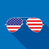 istock Sunglasses USA Flag Icon 1284457652