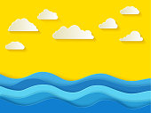 Sunny summer day with white clouds. Sea background in paper style. paper blue waves on a yellow background. Vector illustrations.