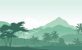 Sunrise in a green tropical mountains.