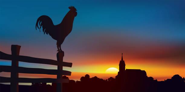 Sunrise on an authentic country landscape with a rooster perched in the foreground. Paysage de campagne au lever du jour avec, au premier plan un coq perché sur une barrière et à l'horizon un village traditionnel de France. sunrise stock illustrations
