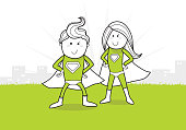 super heroes man and woman standing with a city on the background