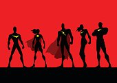 A vector silhouette style illustration of a team of different superheroes. Wide space available for your copy.