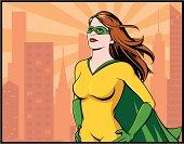 Superhero woman surveys her city.
