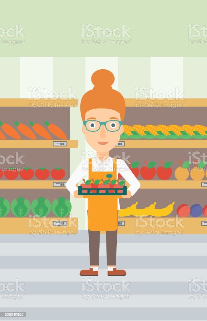 Supermarkt Arbeiter mit im Feld voller Äpfel – Vektorgrafik
