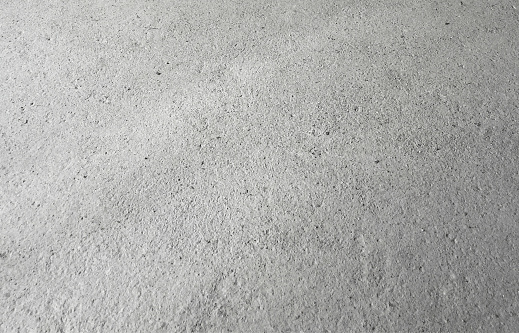 Concrete surface on the floor. Abstract V E C T O R illustration. Unique and modern background. Raw and rough surface. Fantastic grainy light gray pattern with original textured effect. Zoom to see the details. Background with a wide range of uses and great possibilities in graphics.