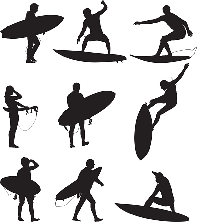 Surfers surfing and carrying their boards