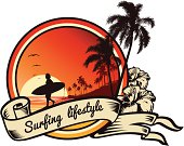 Tropical beach landscape emblem with Surfing Lifestyle lettering in ribbon with hibiscus.
