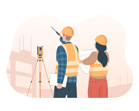 Surveyor engineer with theodolite looking at construction site