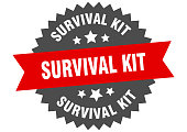 istock survival kit round isolated ribbon label. survival kit sign 1265179288