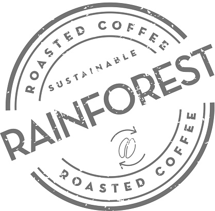 Sustainable Rainforest Roasted Coffee round labels on coffee bean on white background