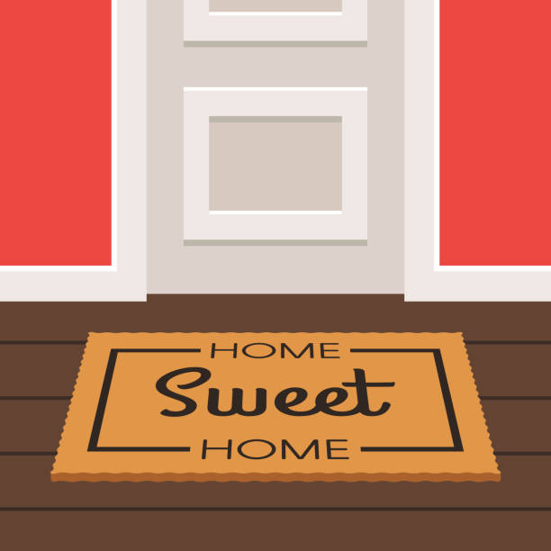 Sweet home doormat and door The inscription home Sweet Home on the Mat doormat before a door. Vector illustration in trendy flat style front stoop stock illustrations