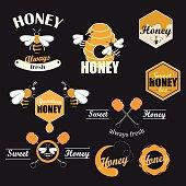 Sweet honey logotypes set. Vector design elements. Badges and labels set.