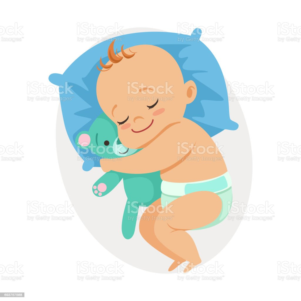 sweet little baby sleeping in his bed and hugging teddy bear