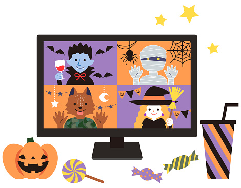 Sweets and Halloween pumpkins placed on the desk, and four monsters displayed on a desktop computer and enjoying a Halloween party remotely over the Internet.