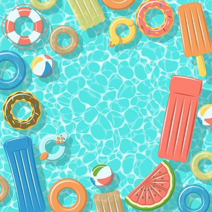 Swimming pool with rafts rubber rings top view