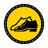 Symbol Enclosed Shoes Are Required In The Manufacturing Area sign on white background