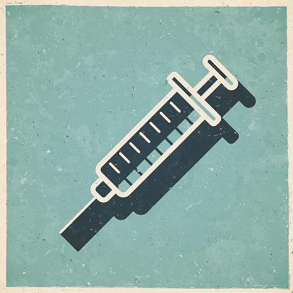 Syringe. Icon in retro vintage style - Old textured paper